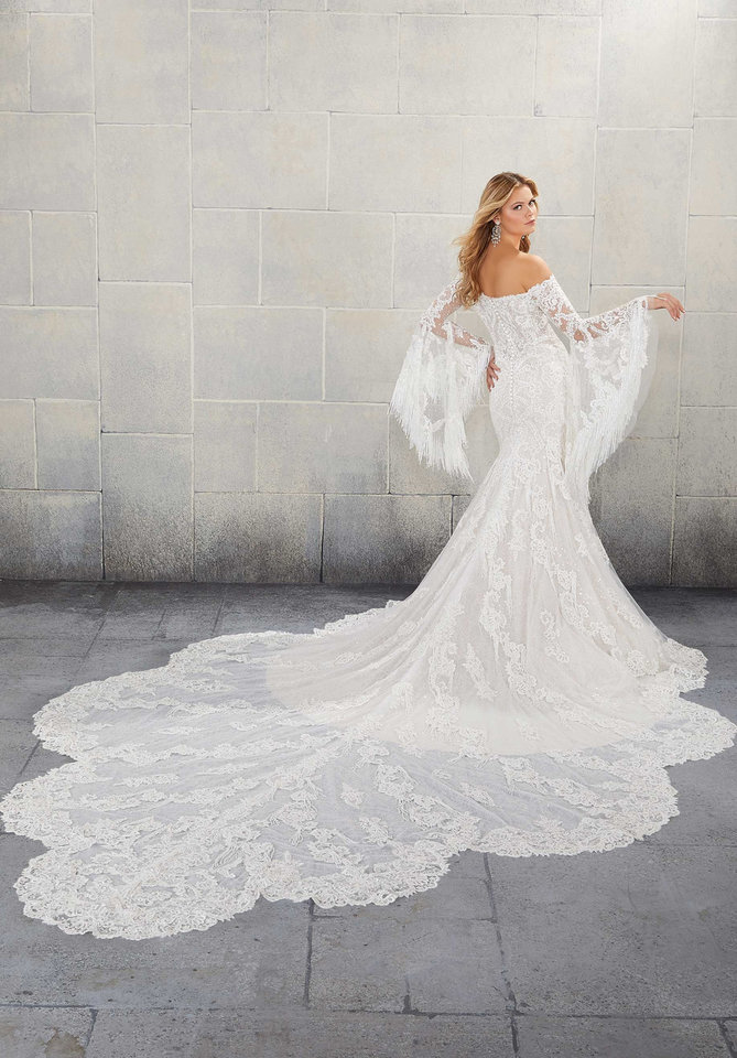 Photo - Long train and voluminous sleeves on a Morilee bridal gown.