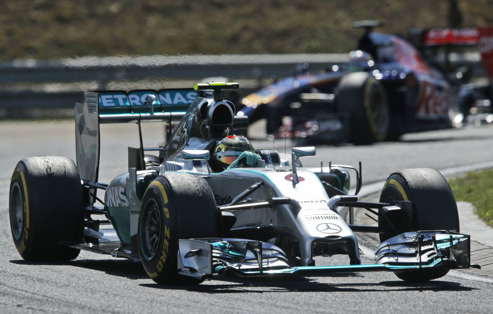 Photo - Mercedes driver Nico Rosberg of Germany steers his car during the free practice session at the Hungarian Formula One Grand Prix in Budapest, Hungary, Friday, July 25, 2014. The Hungarian Formula One Grand Prix will be held on Sunday, July, 27, 2014. (AP Photo/Darko Bandic)