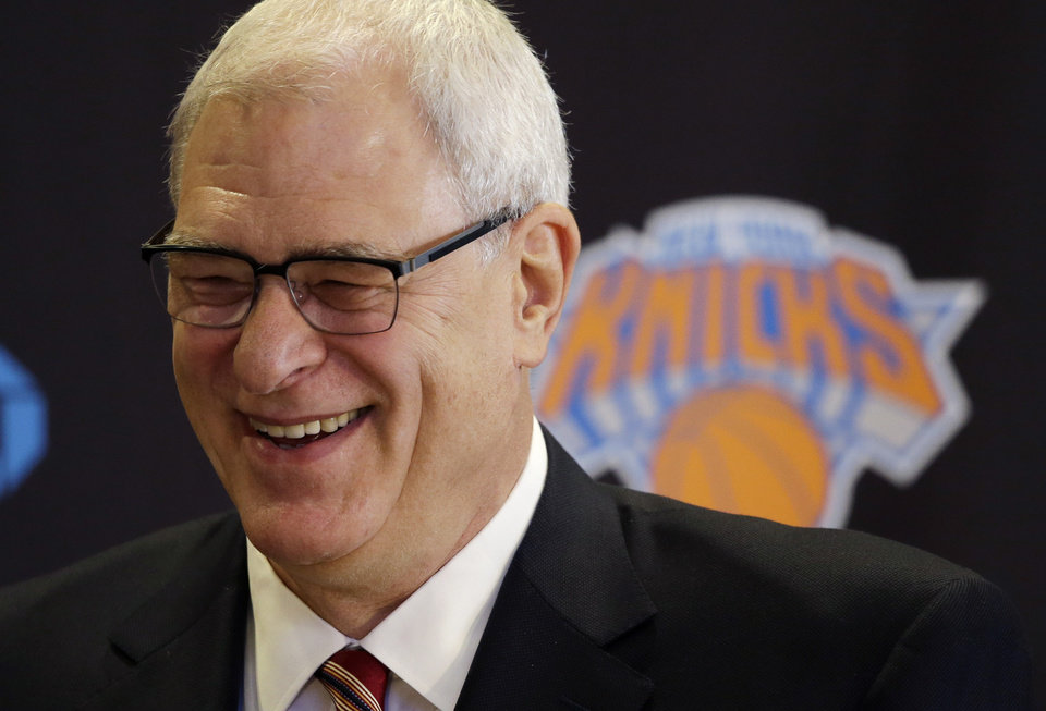 Photo - Phil Jackson smiles as he is introduced as the new president of the New York Knicks, Tuesday, March 18, 2014 in New York. Jackson, who won two NBA titles as a player with the Knicks, also won 11 championships while coaching the Chicago Bulls and the Los Angeles Lakers. (AP Photo/Mark Lennihan)