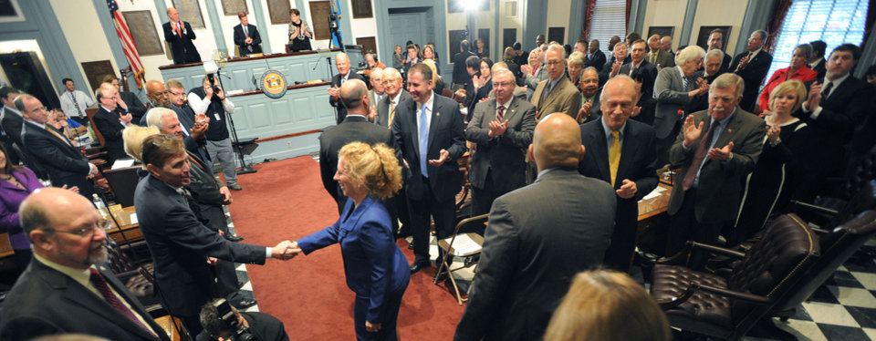 Ann Visalli, director of the office of management and budget, center, enters the Senate chamber along with other cabinet members to hear Delaware Gov. Jack Markell's State of State speech in Dover, Del., Thursday, Jan. 17, 2013. (AP Photo/The News Journal, Gary Emeigh)