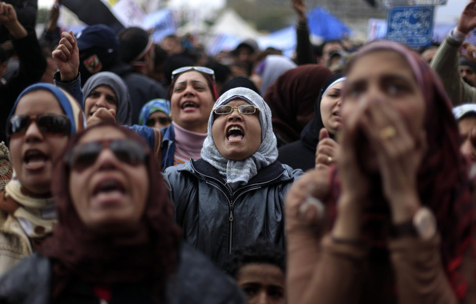 Photo - Egyptian protesters chant anti--government slogans during a rally in Tahrir Square, Cairo, Egypt, Friday, Feb. 1, 2013. Thousands of Egyptians marched across the country, chanting against the rule of the Islamist President Mohammed Morsi, in a fresh wave of protests Friday, even as cracks appeared in the ranks of the opposition after its political leaders met for the first time with the rival Muslim Brotherhood. (AP Photo/Khalil Hamra)