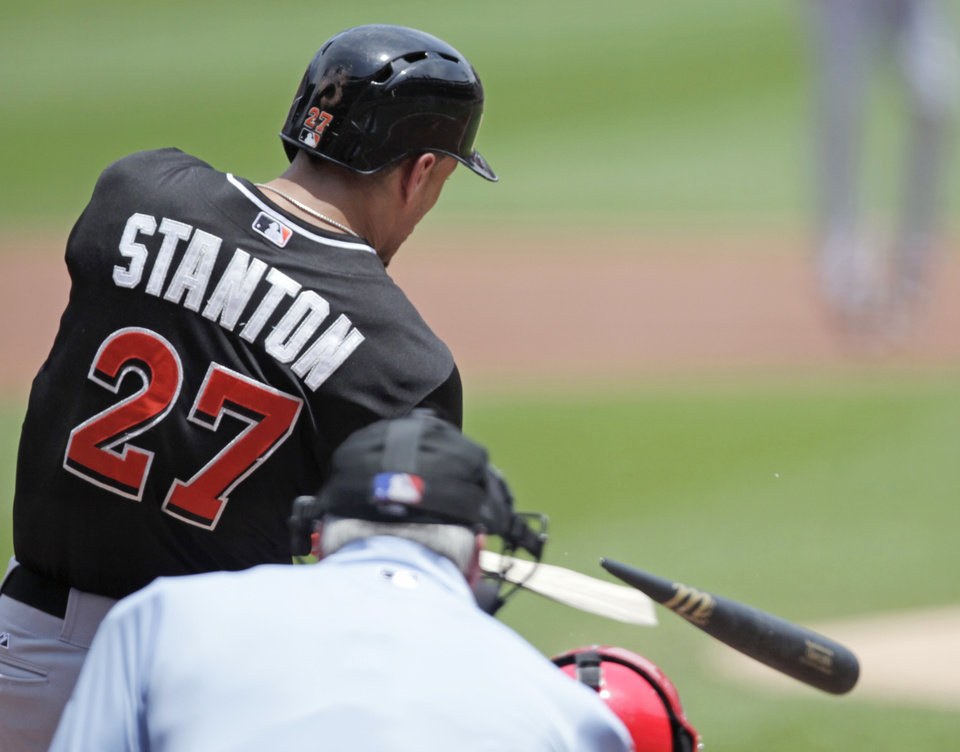Photo - Miami Marlins' Giancarlo Stanton (27) breaks his bat as he hits in the first inning of a baseball game against the St. Louis Cardinals, Sunday, July 6, 2014 in St. Louis. (AP Photo/Tom Gannam)