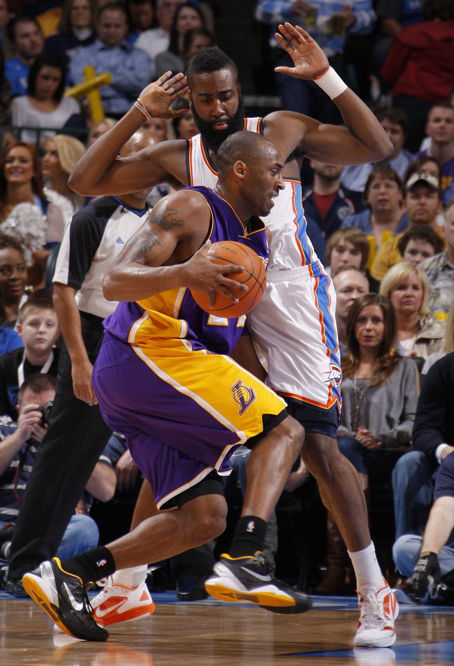 Photo - Oklahoma City's James Harden (13) defends Los Angeles' Kobe Bryant (24) during an NBA basketball game between the Oklahoma City Thunder and the Los Angeles Lakers at Chesapeake Energy Arena in Oklahoma City, Thursday, Feb. 23, 2012. Photo by Bryan Terry, The Oklahoman