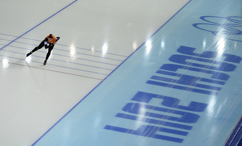 Photo - Jorien ter Mors of the Netherlands skates her way to set a new Olympic record in the women's 1,500-meter race at the Adler Arena Skating Center during the 2014 Winter Olympics in Sochi, Russia, Sunday, Feb. 16, 2014. (AP Photo/Antonin Thuillier, Pool)