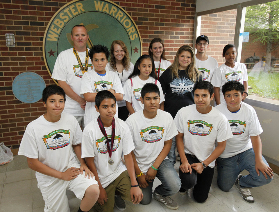 Photo - These Webster Middle School students, who participated in the Oklahoma Memorial Marathon, pose for a photo at their school in Oklahoma City, OK, Friday, May 4, 2012. This is for a story about the life of a middle school.  By Paul Hellstern, The Oklahoman