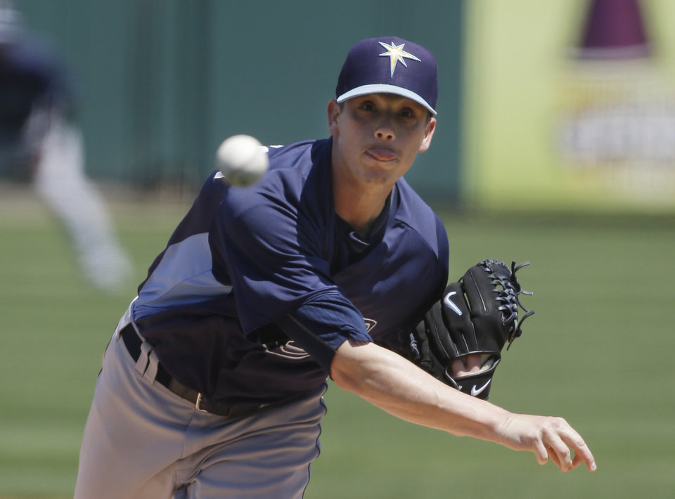 Photo - Tampa Bay Rays starting pitcher Jeremy Hellickson throws during the first inning of an exhibition spring training baseball game against the Detroit Tigers, Friday, March 29, 2013 in Lakeland, Fla. (AP Photo/Carlos Osorio)