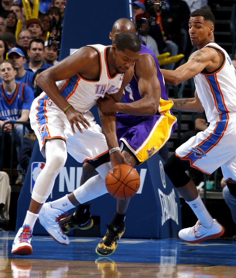 Oklahoma City's Kevin Durant is fouled by Los Angeles' Kobe Bryant during an NBA basketball game between the Oklahoma City Thunder and the Los Angeles Lakers at Chesapeake Energy Arena in Oklahoma City, Tuesday, March 5, 2013. Photo by Bryan Terry, The Oklahoman