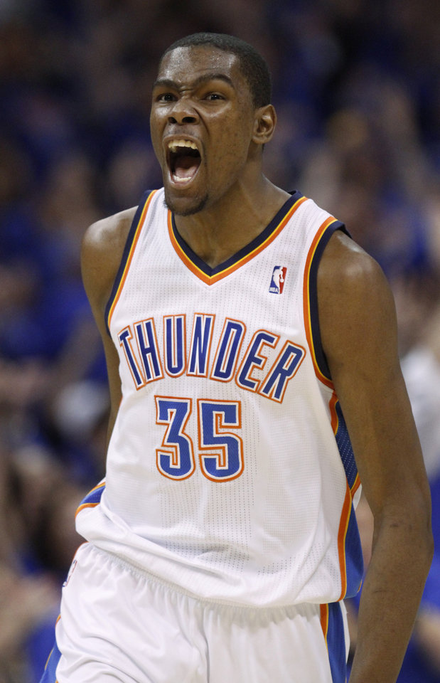 Photo - Oklahoma City Thunder forward Kevin Durant reacts after scoring against the Memphis Grizzlies in the third quarter of Game 7 of a second-round NBA basketball playoff series in Oklahoma City, Sunday, May 15, 2011. (AP Photo/Sue Ogrocki)