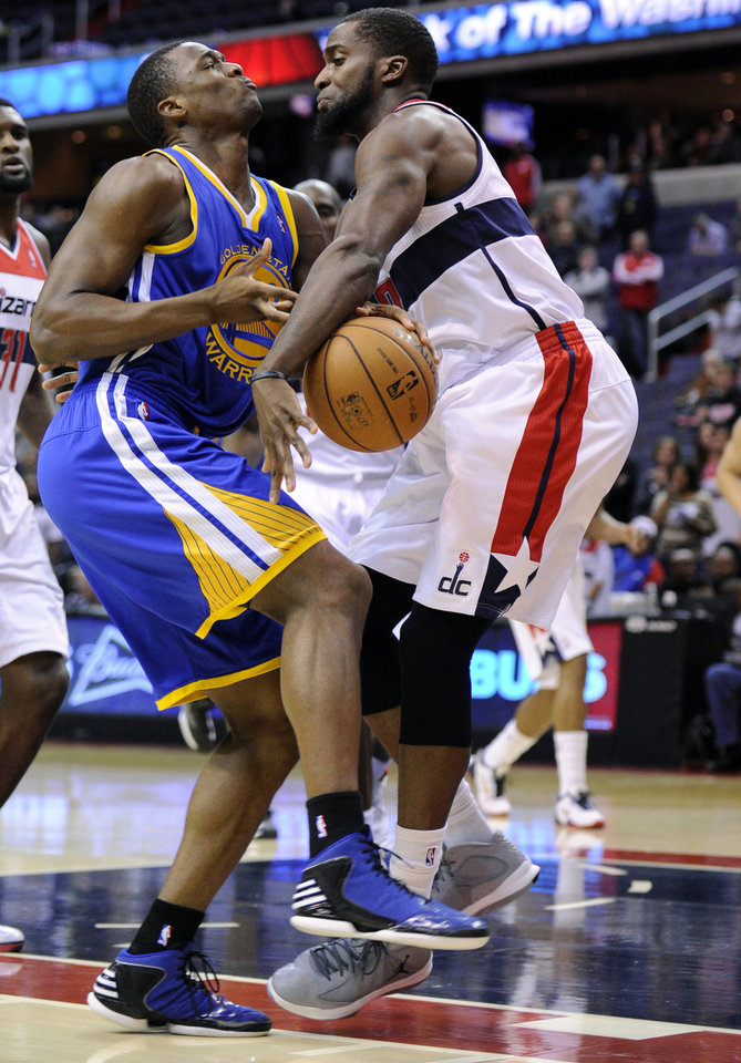 Golden State Warriors forward Harrison Barnes, left, collides with Washington Wizards forward Martell Webster, right, during the first half of an NBA basketball game, Saturday, Dec. 8, 2012, in Washington. (AP Photo/Nick Wass)