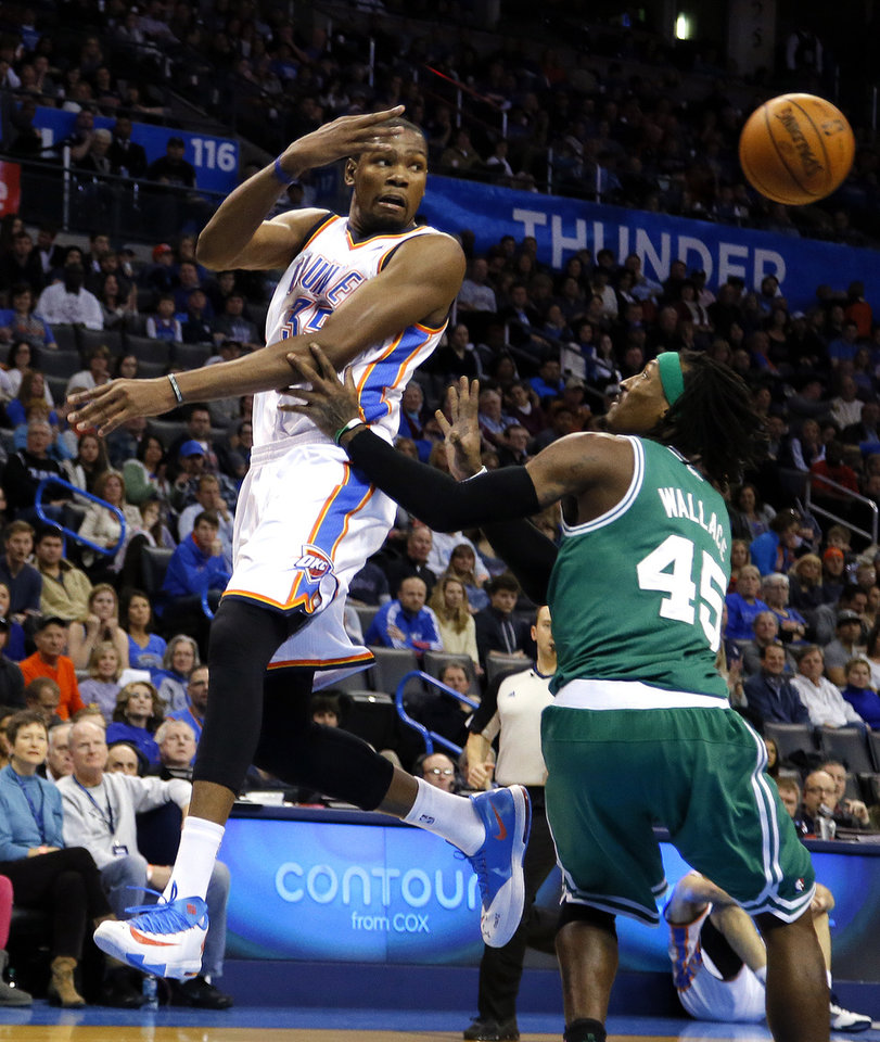 Photo - Oklahoma City's Kevin Durant (35) passes the ball as Boston's Gerald Wallace (45) defends during the NBA game between the Oklahoma City Thunder and the Boston Celtics at the Chesapeake Energy Arena., Sunday, Jan. 5, 2014. Photo by Sarah Phipps, The Oklahoman