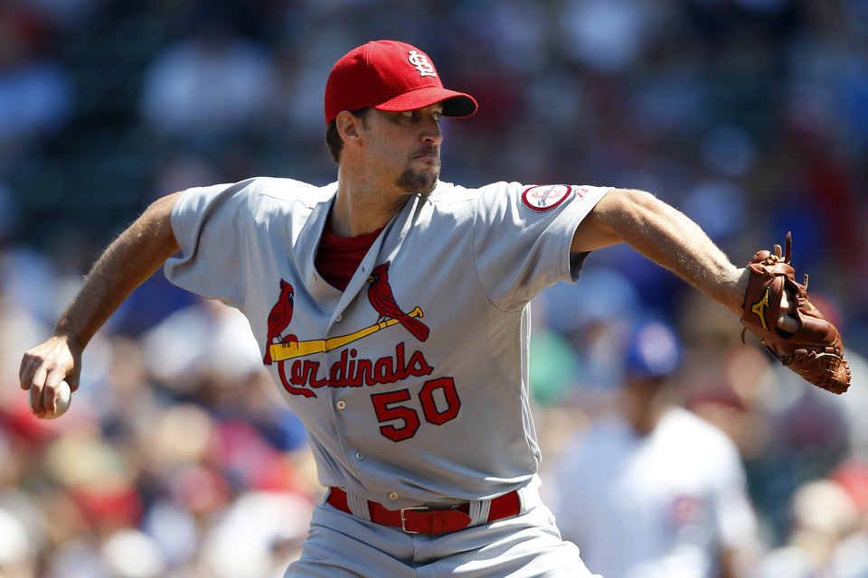 St. Louis Cardinals starting pitcher Adam Wainwright throws against the Chicago Cubs during the first inning of a baseball game on Sunday, Aug. 18, 2013, in Chicago. (AP Photo/Andrew A. Nelles)