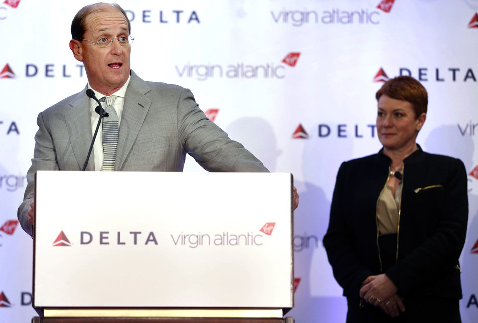Photo - Delta Airlines CEO Richard Anderson speaks while Virgin Atlantic CCO Julie Southern listens during a news conference in New York, Tuesday, Dec. 11, 2012. Delta Air Lines said it will buy almost half of Virgin Atlantic for $360 million as it tries to catch up to rivals in the lucrative New York-to-London travel market. (AP Photo/Seth Wenig)