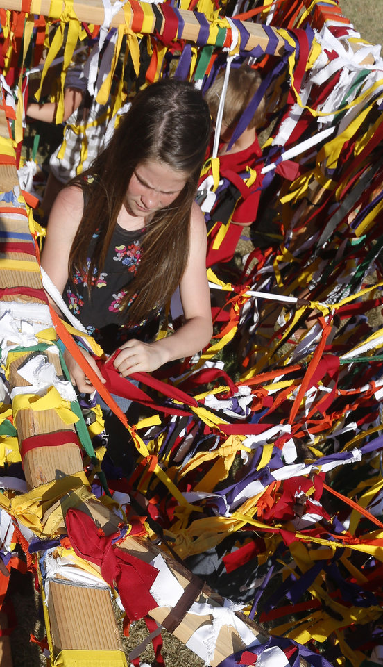 Macee Gifs, 13, works on ties at the creation station during the last day of the Festival of the Arts, Sunday, April 28, 2013. Photo by Doug Hoke, The Oklahoman