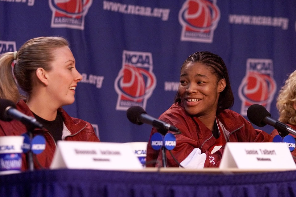 Photo - OU WOMEN'S COLLEGE BASKETBALL, NCAA TOURNAMENT: University of Oklahoma great eight press conference in Boise, Idaho, March 24, 2002. Rosalind Ross, right, talks to Jamie Talbert. Staff photo by Doug Hoke.