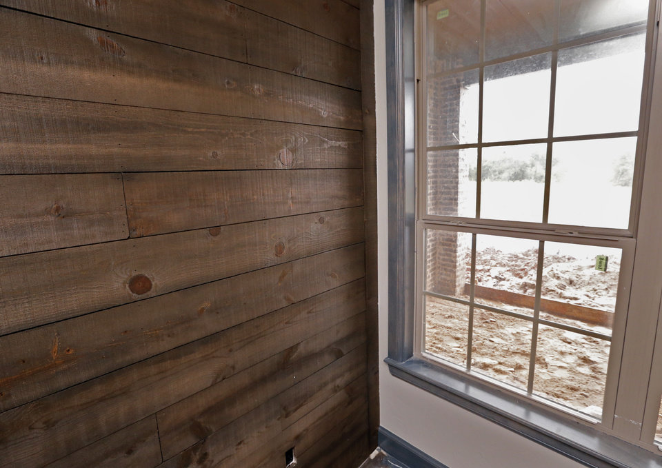 Photo -  Stained pine wall in a downstairs room at the home being built by Tony Foust of DaVinci Homes at 2017 Providence Drive in Norman for the Festival of Homes next weekend and June 12-14 in the Moore and Norman areas. PHOTO BY STEVE SISNEY, THE OKLAHOMAN   STEVE SISNEY -  THE OKLAHOMAN