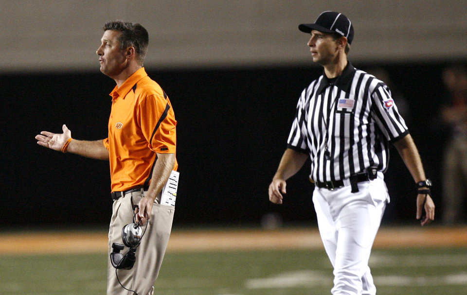 Photo - OSU head coach Mike Gundy argues a call during the college football game between the Washington State Cougars (WSU) and the Oklahoma State Cowboys (OSU) at Boone Pickens Stadium in Stillwater, Okla., Saturday, September 4, 2010. Photo by Sarah Phipps, The Oklahoman