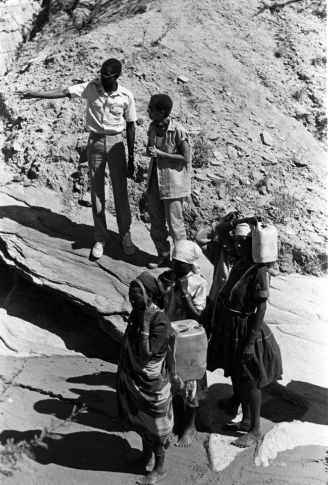 "This undated photo of a World Neighbors project first was published in The Oklahoman on Dec. 15, 1985. The photographer is unknown. The caption reads: ""Joshua Mukusya, left, explains a subsurface dam project to Shari Belafonte-Harper in Machakos, Kenya."" Shari Belafonte -- daughter of singer Harry Belafonte -- was married to Robert Harper from 1977 to 1988. <strong>Unknown - The Oklahoman Archives</strong>"