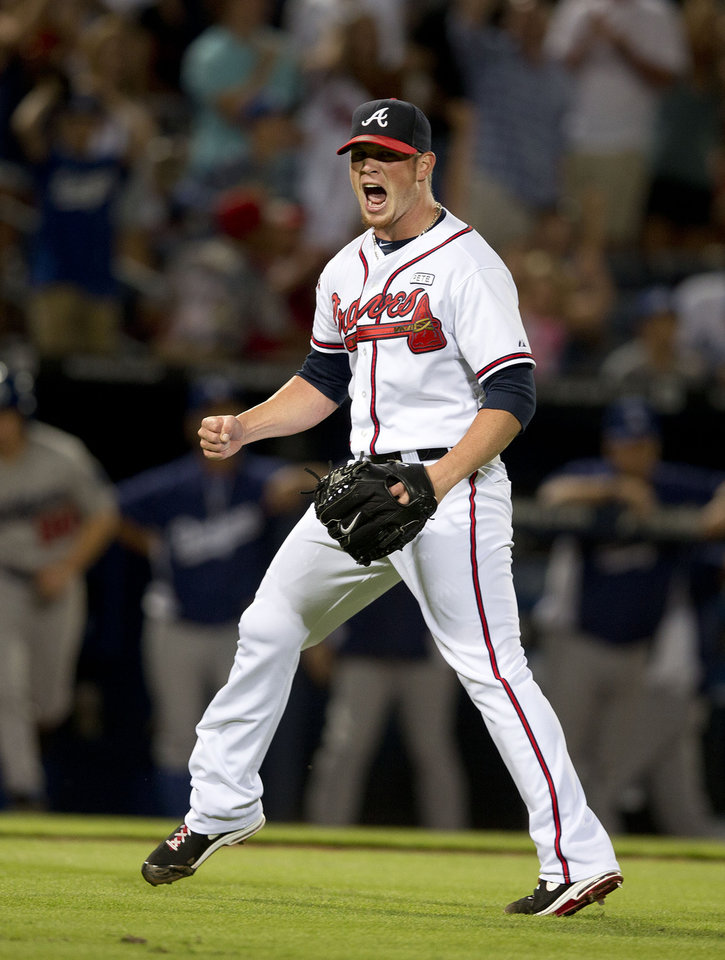 Photo - Atlanta Braves relief pitcher Craig Kimbrel (46) reacts after getting the final out in the ninth inning of a baseball game against the Los Angeles Dodgers Wednesday, Aug. 13, 2014, in Atlanta. Kimbrel earned a save as the Braves 3-2. (AP Photo/John Bazemore)