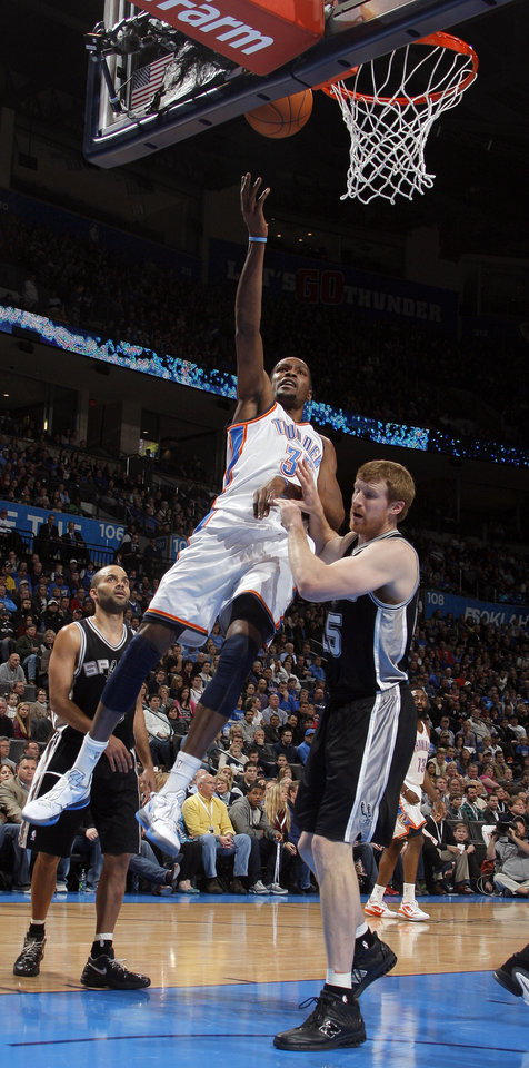 Photo - Oklahoma City Thunder's Kevin Durant (35) shoots a lay up over San Antonio Spurs' Matt Bonner (15) during the the NBA basketball game between the Oklahoma City Thunder and the San Antonio Spurs at the Chesapeake Energy Arena in Oklahoma City, Sunday, Jan. 8, 2012. Photo by Sarah Phipps, The Oklahoman