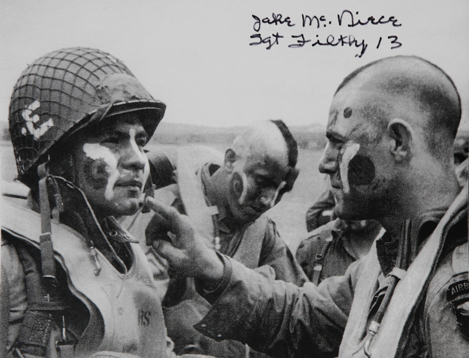 "This photo shows McNiece, right, applying paint to the face of a fellow paratrooper before a mission during World War II.  Mohawk haircuts and face paint were signatures of the Filthy 13. Jake McNiece, 93, was a paratrooper with 101st Airborne who parachuted behind enemy lines in northern France and led a team of men dubbed the ""Filthy 13"" on a demolition mission in advance of the Allied Forces D-Day invasion of beaches at Normandy on  June 6, 1944.  McNiece is photographed at his home in Ponca City on Monday, June 4,  2012,    Photo by Jim Beckel, The Oklahoman"