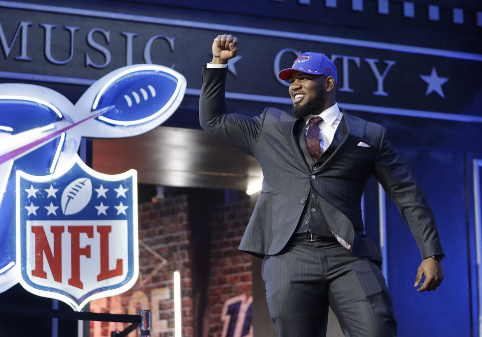 Photo - Houston defensive tackle Ed Oliver takes the stage after the Buffalo Bills selected him in the first round at the NFL football draft, Thursday, April 25, 2019, in Nashville, Tenn. (AP Photo/Mark Humphrey)