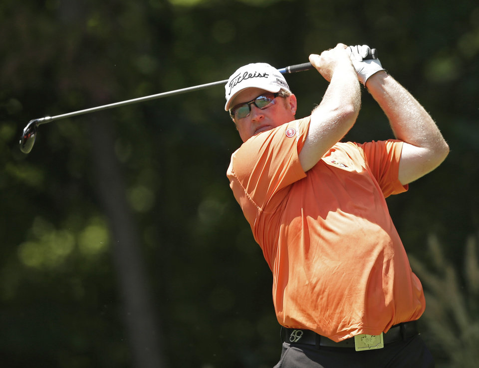 Photo - Brad Fritsch, of Canada, watches his tee shot on the second hole during the third round of the Wyndham Championship golf tournament in Greensboro, N.C., Saturday, Aug. 16, 2014. (AP Photo/Chuck Burton)