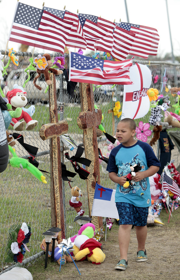 Eric Johnson, a first-grader at Plaza Towers Elementary School, walks around the fence surrounding his school on Wednesday in Moore. Photo by David McDaniel, The Oklahoman <strong>David McDaniel</strong>