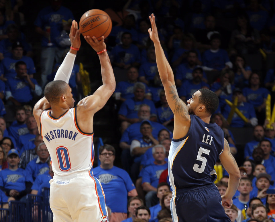 Photo - Oklahoma City's Russell Westbrook (0) shoots over Memphis' Courtney Lee (5) during Game 1 in the first round of the NBA playoffs between the Oklahoma City Thunder and the Memphis Grizzlies at Chesapeake Energy Arena in Oklahoma City, Saturday, April 19, 2014. Photo by Sarah Phipps, The Oklahoman