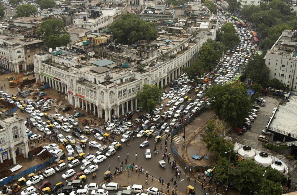 Photo -   Streets are packed in heavy traffics following power outage and rains in the central part of New Delhi, India, Tuesday, July 31, 2012. India's energy crisis spreadover half the country Tuesday when both its eastern and northern electricity gridscollapsed, leaving 600 million people without power in one of the world's biggest-ever blackouts. Traffic lights went out across New Delhi. (AP Photo/Rajesh Kumar Singh)