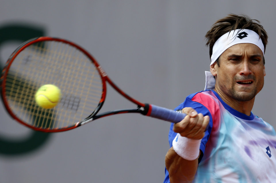 Photo - Spain's David Ferrer returns the ball to Italy's Andreas Seppi during the third round match of  the French Open tennis tournament at the Roland Garros stadium, in Paris, France, Saturday, May 31, 2014. (AP Photo/Darko Vojinovic)