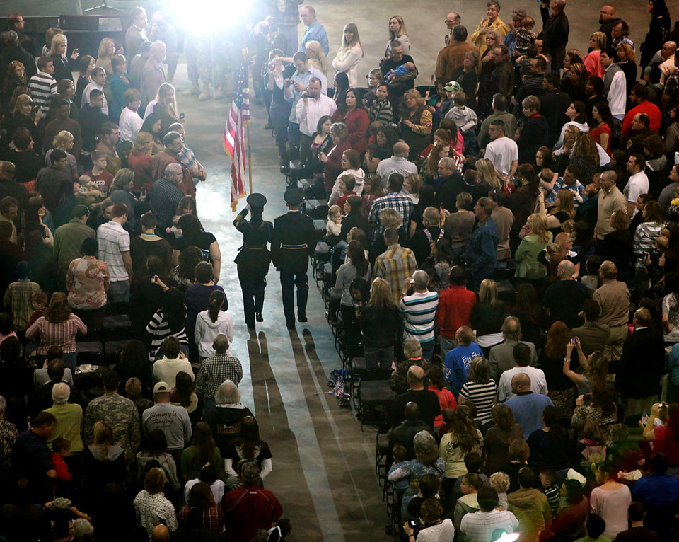 Members of the Color Guard carry the American flag down the aisle toward the stage during the Posting of the Colors during a deployment ceremony for members of the 45th Infantry Brigade Combat Team at The OKC Arena in Oklahoma City on Wednesday, Feb. 16, 2011. Photo by John Clanton, The Oklahoman