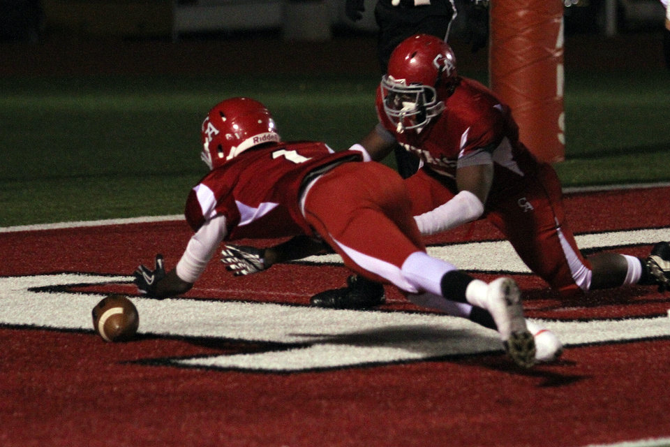 Photo - Carl Albert's Tank Richmond dives on a fumble in the end zone during the Carl Albert Titans - Ardmore Tigers football game Friday night at Jim Harris stadium in Midwest City. PHOTO BY HUGH SCOTT, FOR THE OKLAHOMAN