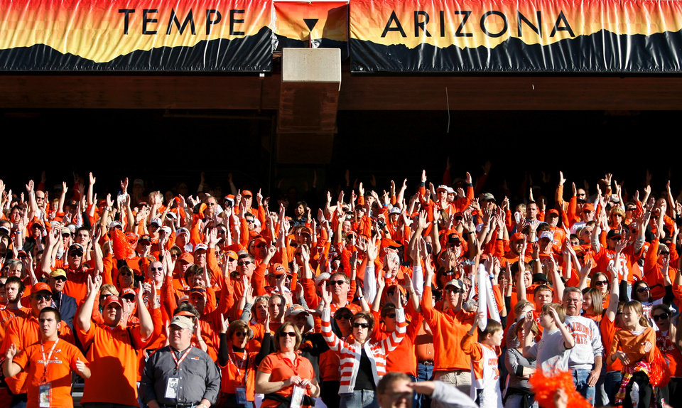 Photo - Cowboy fans cheer in the stands in the first half during the Insight Bowl college football game between Oklahoma State University (OSU) and the Indiana University Hoosiers (IU) at Sun Devil Stadium on Monday, Dec. 31, 2007, in Tempe, Ariz. 