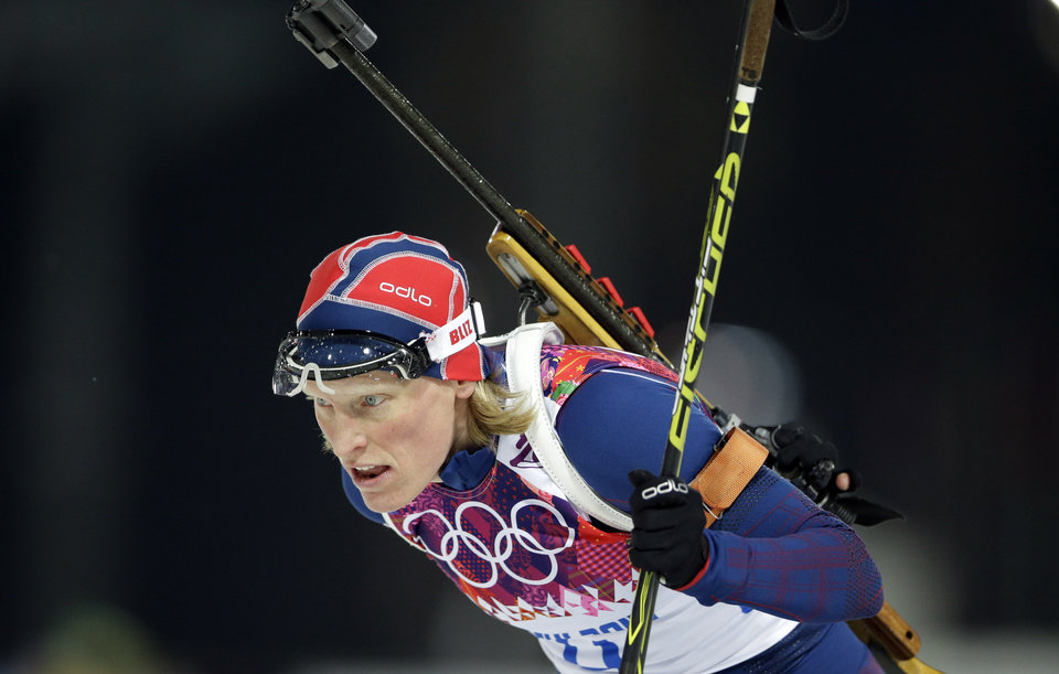 Photo - Norway's Tora Berger leaves the shooting range after shooting during the women's biathlon 12.5k mass-start, at the 2014 Winter Olympics, Monday, Feb. 17, 2014, in Krasnaya Polyana, Russia. (AP Photo/Lee Jin-man)