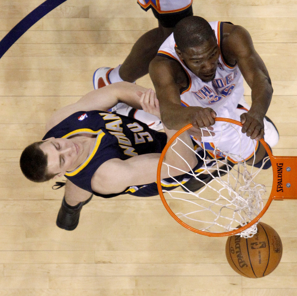 Photo - Oklahoma City's Kevin Durant (35) dunks the ball beside Indiana's Tyler Hansbrough (50)  during the NBA basketball game between the Oklahoma City Thunder and the Indiana Pacers at the Oklahoma City Arena, Wednesday, March 2, 2011. Photo by Bryan Terry, The Oklahoman