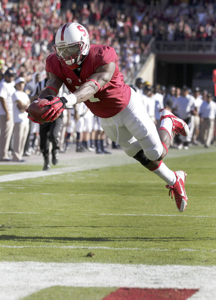 Photo - File - This Nov. 23, 2013, file photo shows Stanford wide receiver Ty Montgomery diving into the end zone for a touchdown against California during the first half of an NCAA college football game in Stanford, Calif. Top wide receiver and All-America kick returner Montgomery has been medically cleared to play in No. 11 Stanford's season opener Saturday, Aug. 30, 2014, against UC Davis. (AP Photo/Tony Avelar, file)