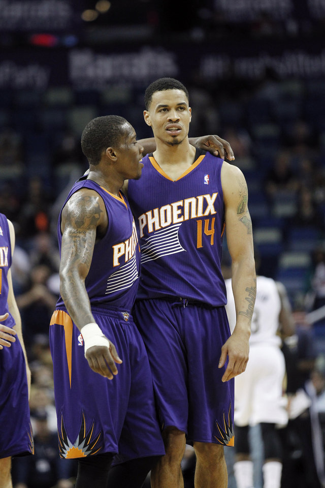 Photo - Phoenix Suns guard Eric Bledsoe, left, talks with guard Gerald Green (14) near the end of an NBA basketball game against the New Orleans Pelicans late in the second half in New Orleans, Wednesday, April 9, 2014. The Suns defeated the Pelicians 94-88. (AP Photo/Bill Haber)