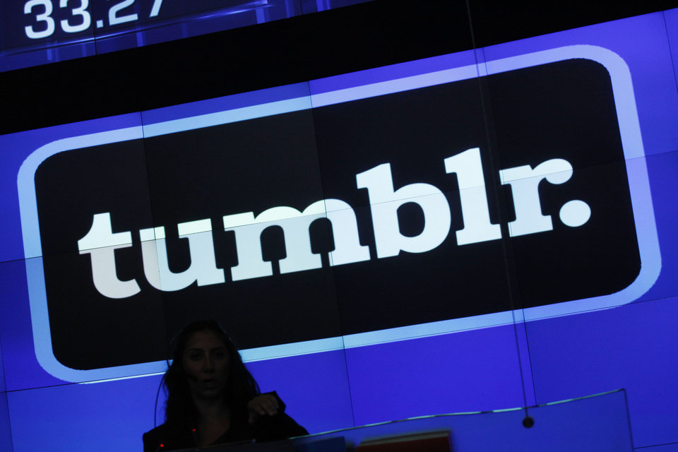 In this Thursday, July 11, 2013 photo, the Tumblr logo is displayed at Nasdaq, in New York. Yahoo has paid $1.1 billion to buy the blogging site Tumblr in one of this year's most buzzed-about deals. Now, Tumblr is flaunting its hipster credentials with a first-ever breakdown of the year's hottest trends, topics and celebrities. The retrospective starts Tuesday, Dec. 3, 2013, with an exploration of 20 categories ranging from the most popular musical groups to the most interesting architecture of 2013. (AP Photo/Mark Lennihan)