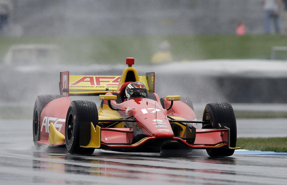 Photo - Sebastian Saavedra, of Colombia, drives into turn 2 on his way to winning the pole during qualifications for the inaugural Grand Prix of Indianapolis IndyCar auto race at the Indianapolis Motor Speedway in Indianapolis, Friday, May 9, 2014. (AP Photo/Michael Conroy)