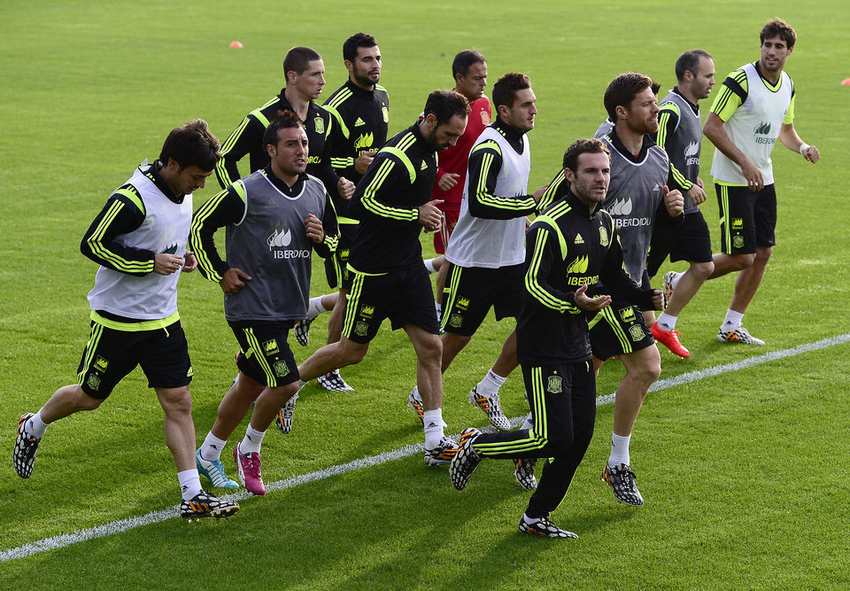 Photo - Spanish national team players jog during a training session at the Atletico Paranaense training center in Curitiba, Brazil, Monday, June 9, 2014. Spain will play in group B of the Brazil 2014 World Cup. (AP Photo/Manu Fernandez)