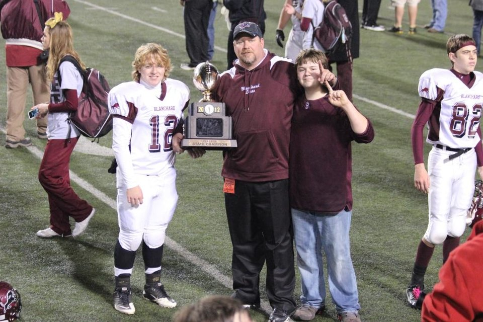 Blanchard Football Champs - Coach and Sons with Gold Ball