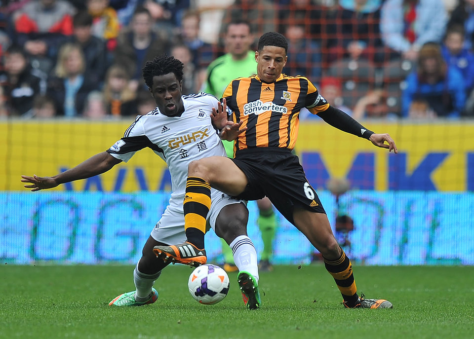 Photo - Hull City's Curtis Davies, right, and Swansea City's Wilfried Bony battle for the ball during their English Premier League soccer match at the KC Stadium, Hull, England, Saturday, April 5, 2014. (AP Photo/Dave Howarth, PA Wire)   UNITED KINGDOM OUT     -    NO SALES   -    NO ARCHIVES