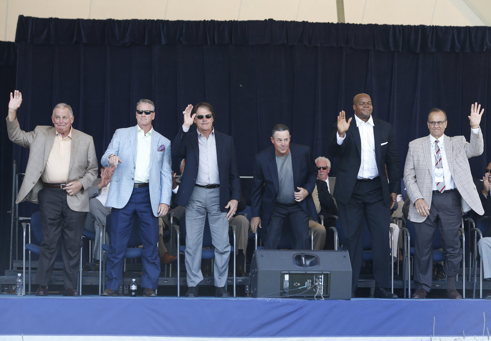 Photo - Baseball Hall of Fame electees Bobby Cox, Tom Glavine, Tony La Russa, Greg Maddux, Frank Thomas and Joe Torre are introduced during an awards ceremony at Doubleday Field on Saturday, July 26, 2014, in Cooperstown, N.Y. They will be inducted on Sunday. (AP Photo/Mike Groll)