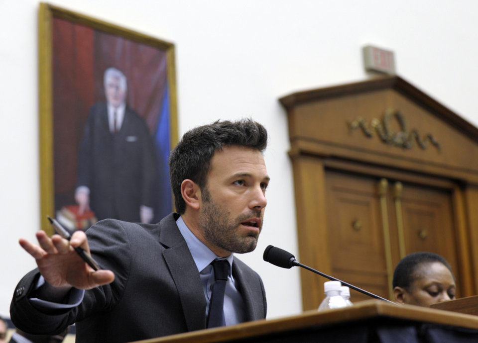 Photo - Ben Affleck, actor and founder of the Eastern Congo Initiative, testifies before the House Armed Services Committee on the evolving security situation in the Democratic Republic of the Congo during a hearing on Capitol Hill in Washington, Wednesday, Dec. 19, 2012. (AP Photo/Susan Walsh)