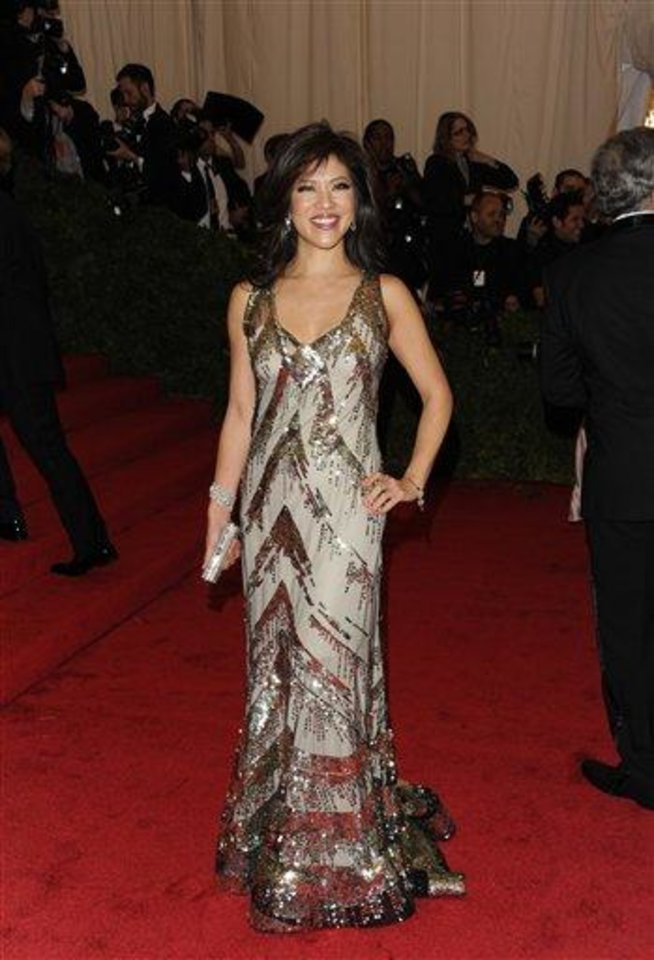 Photo - Julie Chen arrives at the Metropolitan Museum of Art Costume Institute gala benefit, celebrating Elsa Schiaparelli and Miuccia Prada, Monday, May 7, 2012 in New York. (AP Photo/Evan Agostini)