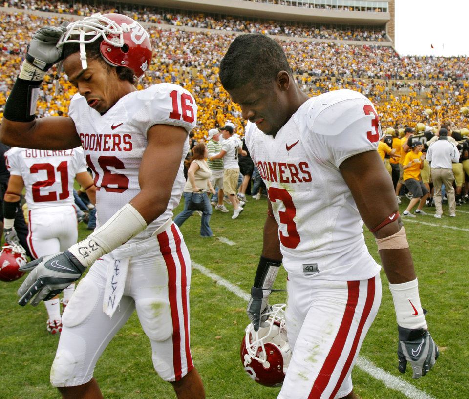 Oklahoma\'s Lewis Baker (16) and Reggie Smith (3) walk off the field as Colorado celebrates the 27-24 upset over the Sooners during the college football game between the University of Oklahoma Sooners (OU) and the University of Colorado Buffaloes (CU) at Folsom Field on Saturday, Sept. 28, 2007, in Boulder, Co. By CHRIS LANDSBERGER, The Oklahoman