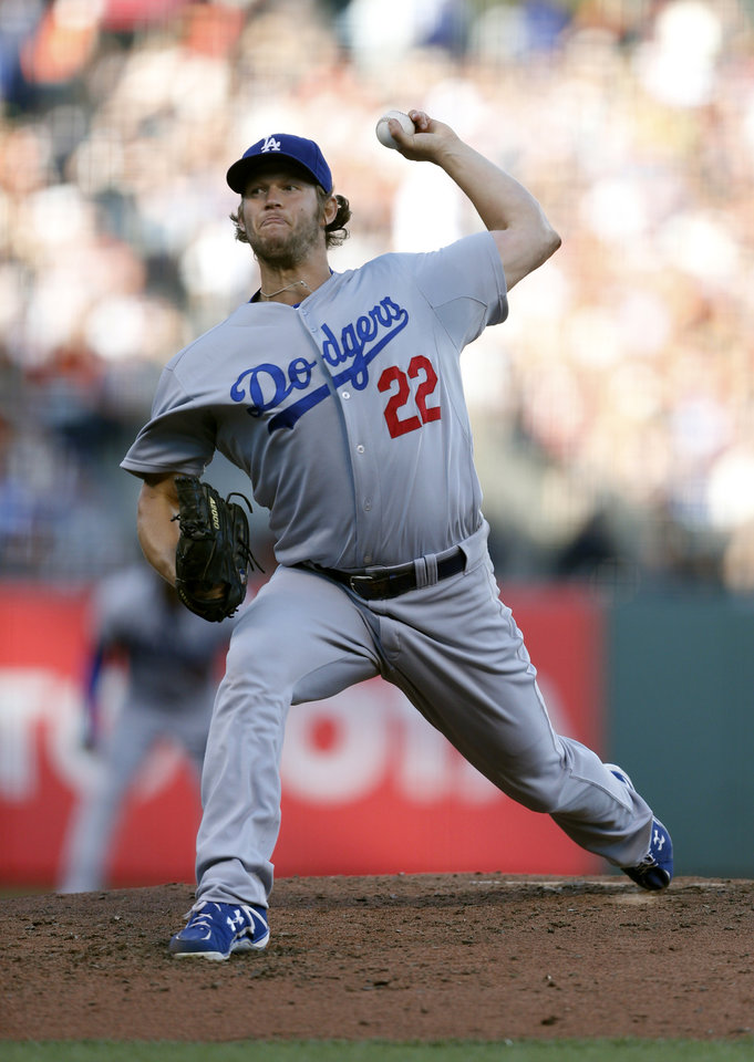 Photo - Los Angeles Dodgers starting pitcher Clayton Kershaw winds up during the third inning of a baseball game against the San Francisco Giants, Saturday, July 26, 2014, in San Francisco. (AP Photo/Beck Diefenbach)