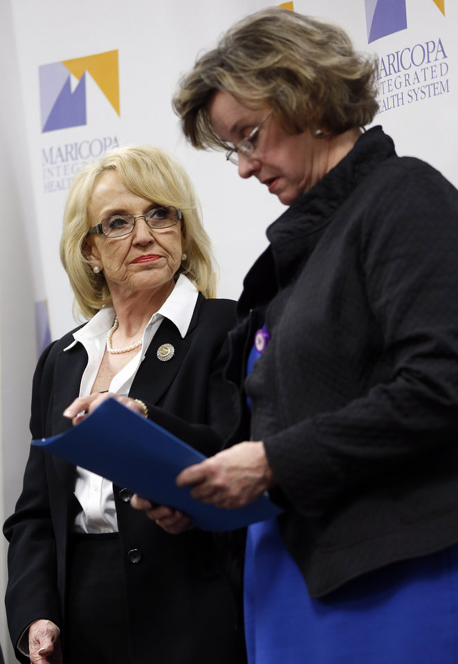 Arizona Gov. Jan Brewer, left, interacts with Maricopa Medical Center CEO Betsey Bayless after Brewer called for the expansion of Medicaid, Wednesday, Jan. 26, 2013 in Phoenix. An expansion would call for $8 billion in federal assistance for the State over three years. (AP Photo/Matt York)