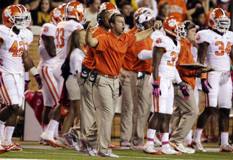 Photo -   Clemson head coach Dabo Swinney directs his team against Wake Forest during the first half of an NCAA college football game in Winston-Salem, N.C., Thursday, Oct. 25, 2012. (AP Photo/Chuck Burton)