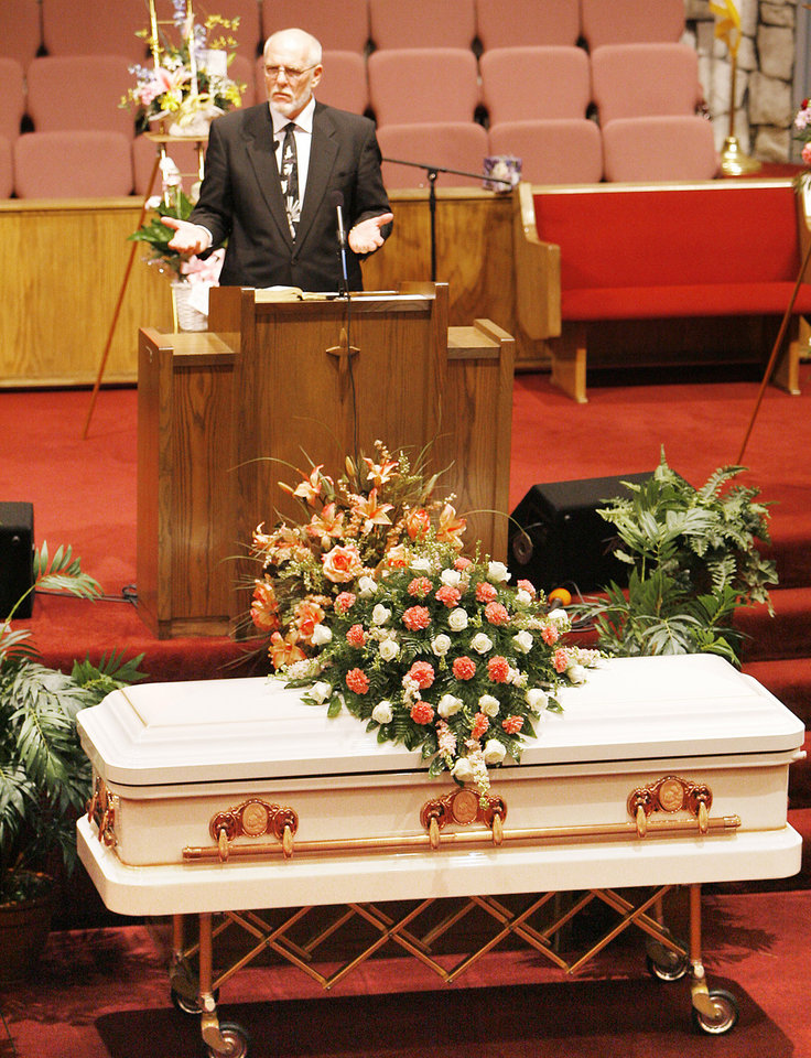 Photo - The Rev. Ron King speaks at Taylor Paschal-Placker funeral in Dewar, Friday, June 13, 2008. King recently found out he was kin to Taylor at a family reunion.   Taylor and her friend  Skyla Whitaker were shot and killed last Sunday on the dirt road near one of their homes, Thursday, June 12, 2008.    Photo by David McDaniel/The Oklahoman